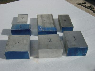 Lot of 7 6061 T651 aluminum blocks.